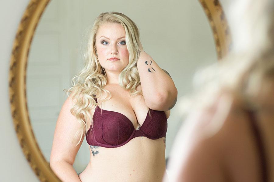 curvy blond boudoir tattoos mirror burgundy bra